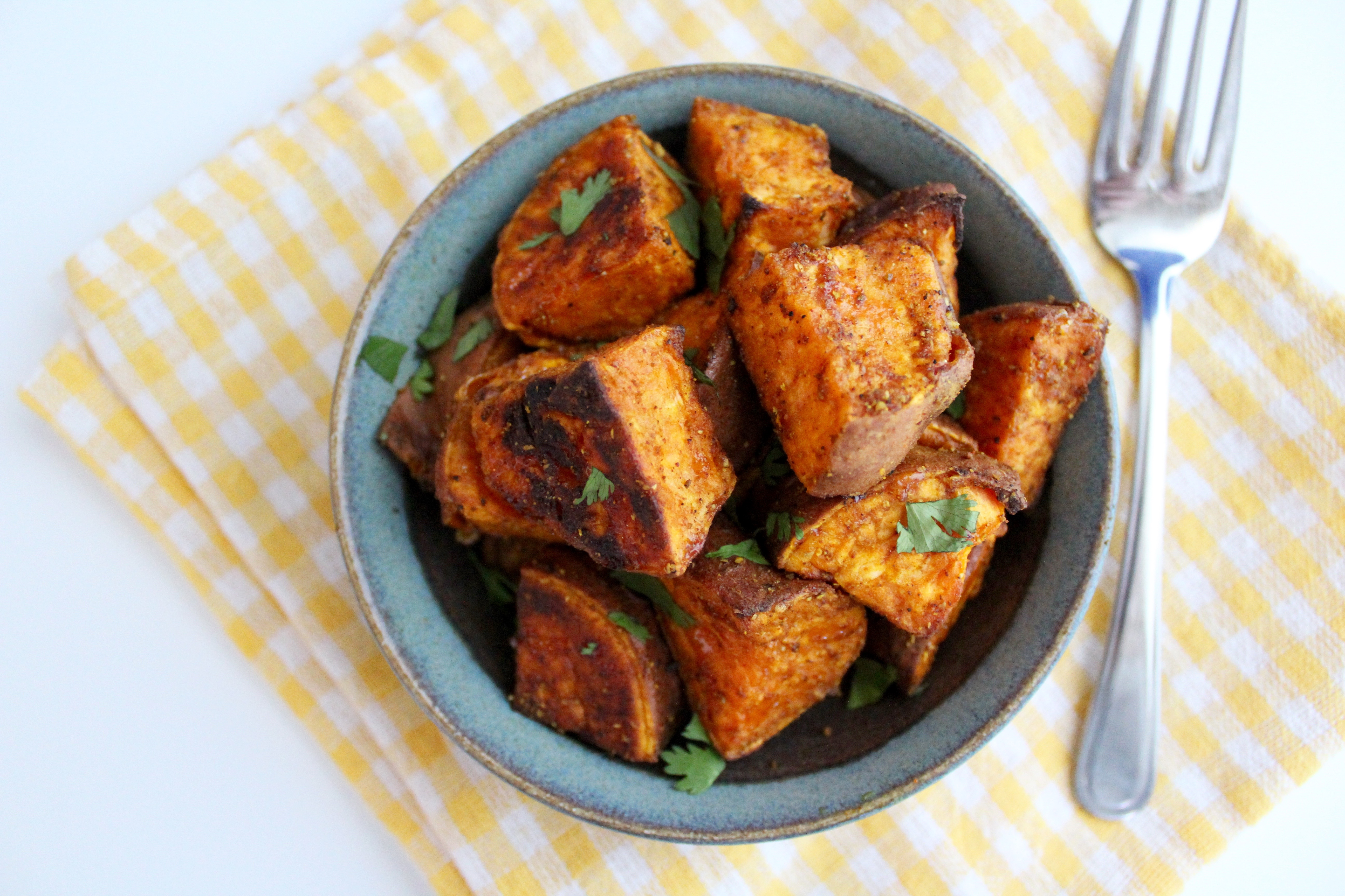 YUM! These Spicy Curry Roasted Sweet Potatoes are unreal!! The best sweet and spicy dish!